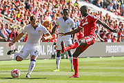 Middlesbrough midfielder Grant Leadbitter tries to stop the cross from Leeds United defender Gaetano Berardi   during the Sky Bet Championship match between Middlesbrough and Leeds United at the Riverside Stadium, Middlesbrough, England on 27 September 2015. Photo by Simon Davies.