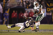 SAN DIEGO, CA - JANUARY 8:  Wide receiver Santana Moss #83 of the New York Jets puts a spin move on safety Clinton Hart #42 of the San Diego Chargers. Moss caught 4 passes for 100 yards and one touchdown at Qualcomm Stadium on January 8, 2005 in San Diego, California. The Jets defeated the Chargers 20-17 in overtime in the AFC Wild Card Game. ©Paul Anthony Spinelli  *** Local Caption *** Santana Moss; Clinton Hart