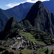 "Machu Picchu is a pre-Columbian Inca site located 2,400 meters (7,875 ft) above sea level. It is situated on a mountain ridge above the Urubamba Valley in Peru, which is 80 km (50 mi) northwest of Cuzco and through which the Urubamba River flows. The river is a partially navigable headwater of the Amazon River. Often referred to as ""The Lost City of the Incas"", Machu Picchu is one of the most familiar symbols of the Inca Empire. It was built around the year 1460, but was abandoned as an official site for the Inca rulers a hundred years later, at the time of the Spanish conquest of the Inca Empire. Although known locally, it was said to have been forgotten for centuries when the site was brought to worldwide attention in 1911 by Hiram Bingham, an American historian. Machu Picchu was declared a Peruvian Historical Sanctuary in 1981 and a UNESCO World Heritage Site in 1983. It is especially important as a cultural site and considered a sacred place."