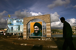 A photograph of Sayyed Hassan Nasrallah, Secretary General of Hezbollah, stands in the main square of Mais Al Jabal, southern Lebanon. Earlier in the week hundreds of thousands of pro-Syrian protesters answered the nationwide call from Hezbollah, the militant Shiite Muslim group, to demonstrate against foreign intervention.