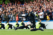 Liverpool goalkeeper Adrián (13) saves a shot from Chelsea forward Tammy Abraham (9) (not in picture) during the Premier League match between Chelsea and Liverpool at Stamford Bridge, London, England on 22 September 2019.