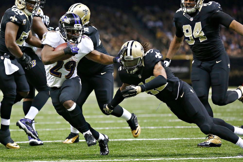 NEW ORLEANS, LA - NOVEMBER 24:  Justin Forsett #29 of the Baltimore Ravens stiff arms Pierre Warren #42 of the New Orleans Saints at Mercedes-Benz Superdome on November 24, 2014 in New Orleans, Louisiana.  The Ravens defeated the Saints 34-27.  (Photo by Wesley Hitt/Getty Images) *** Local Caption *** Justin Forsett; Pierre Warren