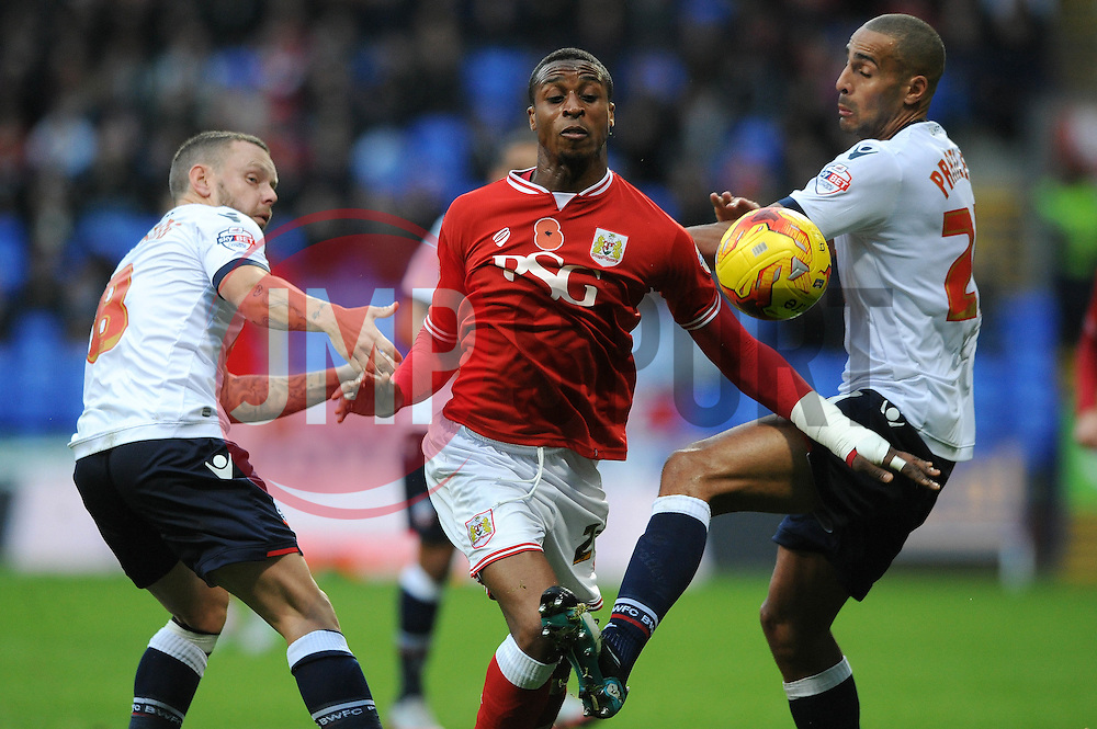 Jonathan Kodjia of Bristol City jostles for the ball with Jay Spearing of Bolton Wanderers and Darren Pratley - Mandatory byline: Dougie Allward/JMP - 07966 386802 - 07/11/2015 - FOOTBALL - Macron Stadium - Bolton, England - Bolton Wanderers v Bristol City - Sky Bet Championship