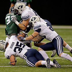 Sep 12, 2009; New Orleans, LA, USA;  BYU Cougars defenders tackle Tulane Green Wave running back Andre Anderson (32) during the first half at the Louisiana Superdome.  BYU defeated Tulane 54-3. Mandatory Credit: Derick E. Hingle-US PRESSWIRE