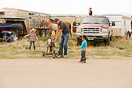 Rocky Boy Rodeo, Indians, families, horses, Rocky Boy Reservation, Montana, Charlie Ereaux, Gro Ventre, gives a hand to his family kids