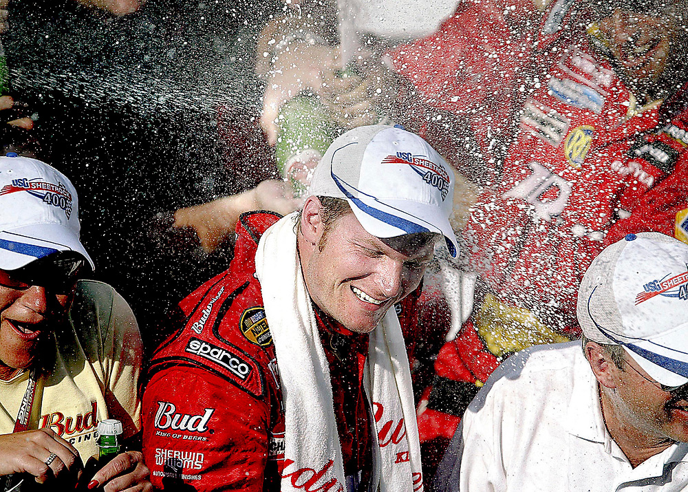 Dale Earnhardt Jr., celebrates with his team after winning the USG Sheetrock 400 at Chicagoland Speedway in Joliet, Ill., Sunday, July 10, 2005. The win is his first NASCAR Nextel Cup victory of the season.
