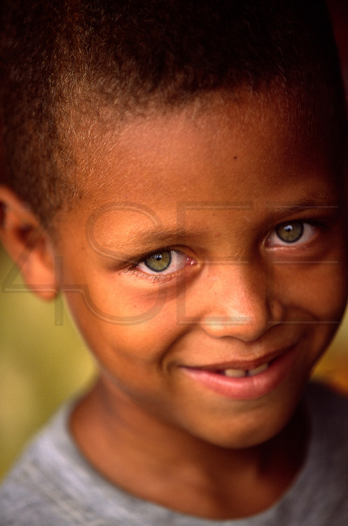 A Cape Verdean descendant with green eyes. A big part of Sao Tome and Principe population descend from Cape Verde workers and slaves who were brought to work in cocoa plantations.