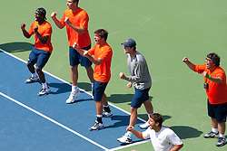 May 24, 2011; Stanford, CA, USA;  The Virginia Cavaliers celebrate after number 3 singles player Sanam Singh (not pictured) wins a point against Southern California Trojans Daniel Nguyen (not pictured) during the finals of the men's team 2011 NCAA Tennis Championships at the Taube Tennis Center. USC defeated UVA 4-3.