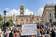 Roma 18 Novembre 2014<br /> Protesta in motorino,  al Campidoglio per chiedere le dimissioni del sindaco di Roma Ignazio Marino, per le multe non pagate,della Panda rossa. La protesta in motorino, è stata organizzata dal Comitato Cuoritaliani.<br /> Rome November 18, 2014<br /> Protest on scooters, on Capitol Hill to demand the resignation of the mayor of Rome Ignazio Marino, for unpaid fines, to  its Red Panda. The protest in the scooters, was organized by the Committee Cuoritaliani