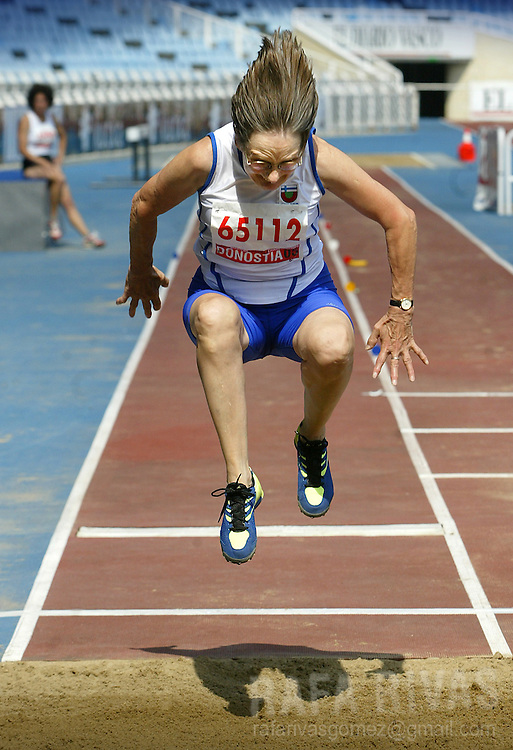 Finnish athlete Marjatta Taipale, 66, takes part in the women's long jump final, 29 August 2005 during the celebration of the XVI WMA World Master Athletics Championships Stadia 2005, in the northern Spanish Basque town of San Sebastian
