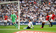 Tottenham Hotspur's Dele Alli scores his side's first goal of the game during the Emirates FA Cup semi-final match at Wembley Stadium, London.