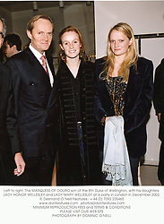 Left to right, The MARQUESS OF DOURO son of the 8th Duke of Wellington, with his daughters LADY HONOR WELLESLEY and LADY MARY WELLESLEY at a party in London in December 2002.