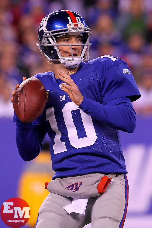 Dec 4, 2011; East Rutherford, NJ, USA; New York Giants quarterback Eli Manning (10) throws a pass during the first half of their game against the Green Bay Packers at MetLife Stadium.