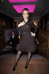 TARA PALMER-TOMKINSON at the Krug Mindshare Charity Auction held at Christie's, 8 King Street, London SW1 on November 2009.