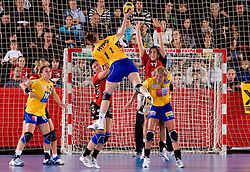 Marion Limal  of Hypo  vs Urska Vidic and Andrea Lekic of Krim at handball match of Round 3 of Champions League between RK Krim Mercator and Hypo Niederosterreich, on November 8, 2009, in Arena Kodeljevo, Ljubljana, Slovenia.  Krim won 35:24. (Photo by Vid Ponikvar / Sportida)