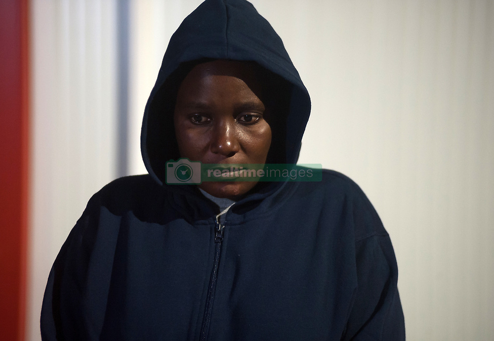 April 27, 2019 - Malaga, Spain - A migrant women is seen looking on outside of a humanitarian emergency stall after her arrival at the Port of Malaga. Spain's Maritime Rescue service rescued 56 migrants aboard a dinghy  crossing the Alboran Sea and brought them to Malaga harbour, where they were assisted by the Spanish Red Cross. (Credit Image: © Jesus Merida/SOPA Images via ZUMA Wire)
