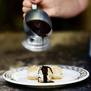 profiteroles with chocolate and vanilla ice cream