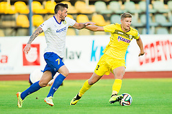 Ivica Guberac #7 of Luka Koper vs Luka Vrhunc of Radomlje during football match between NK Kalcer Radomlje and FC Luka Koper in Round 1 of Prva liga Telekom Slovenije 2014/15, on July 20, 2014 in Sportni park, Domzale, Slovenia. Photo by Vid Ponikvar / Sportida.com