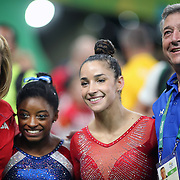 Gymnastics - Olympics: Day 6 Simone Biles #391 of the United States and Alexandra Raisman #395 of the United States after winning gold and silver medal medals with their coaches Aimee Boorman and Mihai Brestyan during the Artistic Gymnastics Women's Individual All-Around Final at the Rio Olympic Arena on August 11, 2016 in Rio de Janeiro, Brazil. (Photo by Tim Clayton/Corbis via Getty Images)