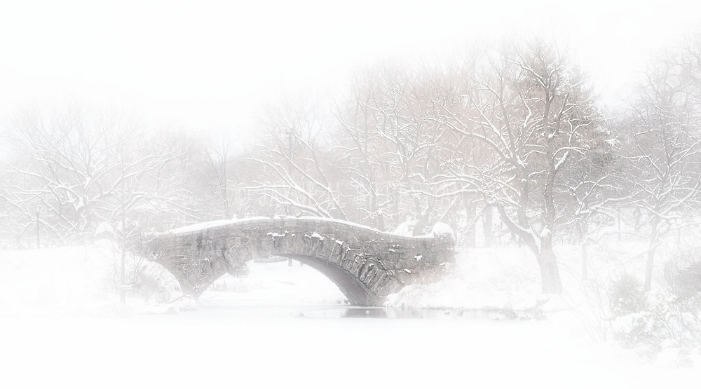 Capstow Bridge in Central Park on a snowy, foggy winter's day.