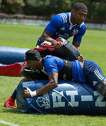 April 3, 2018 - Hong Kong, Hong Kong SAR, CHINA - HONG KONG,HONG KONG SAR,CHINA:April 3rd 2018. The USA Rugby team conduct a training session at So Kon Po recreation ground ahead of their Hong Kong Rugby 7's matches.Perry Baker (bottom) pushes through the tackling pads held by Kevin Williams (Credit Image: © Jayne Russell via ZUMA Wire)