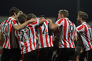 Rob Dickie scores and celebrates his  second goal during the FA Trophy match between Cheltenham Town and Chelmsford City at Whaddon Road, Cheltenham, England on 12 December 2015. Photo by Antony Thompson.