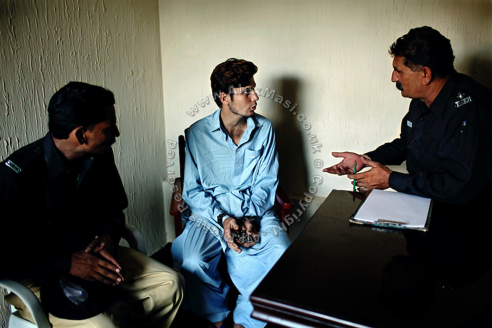 A kidnap suspect (center) is being questioned by two members of the AVCC, (Anti-Violence Crime Cell) a special police unit mostly involved in anti-terrorism operations and kidnap cases in the city of Karachi, Pakistan's main economic hub.