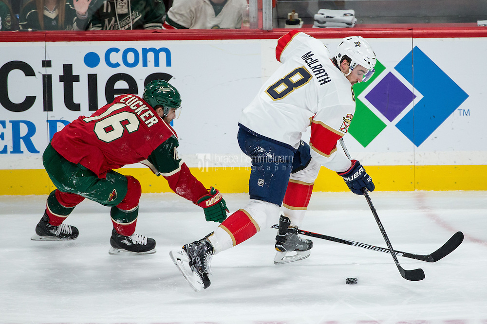 Dec 13, 2016; Saint Paul, MN, USA; Florida Panthers defenseman Dylan McIlrath (8) protects the puck from Minnesota Wild forward Jason Zucker (16) during the third period at Xcel Energy Center. The Wild defeated the Panthers 5-1. Mandatory Credit: Brace Hemmelgarn-USA TODAY Sports