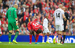 13.09.2014, Anfield, Liverpool, ENG, Premier League, FC Liverpool vs Aston Villa, 4. Runde, im Bild Liverpool's Mario Balotelli goes down injured after a clash with Aston Villa's Philippe Senderos // during the English Premier League 4th round match between Liverpool FC and Aston Villa at Anfield in Liverpool, Great Britain on 2014/09/13. EXPA Pictures &copy; 2014, PhotoCredit: EXPA/ Propagandaphoto/ David Rawcliffe<br /> <br /> *****ATTENTION - OUT of ENG, GBR*****