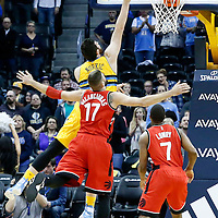 18 November 2016: Denver Nuggets center Jusuf Nurkic (23) goes for the layup past Toronto Raptors center Jonas Valanciunas (17) and Toronto Raptors guard Kyle Lowry (7) during the Toronto Raptors 113-111 OT victory over the Denver Nuggets, at the Pepsi Center, Denver, Colorado, USA.