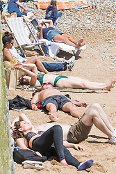 © Licensed to London News Pictures. 03/06/2017. Brighton, UK. Members of the public enjoy the sunny weather by spending the Saturday afternoon on the beach in Brighton and Hove. Photo credit: Hugo Michiels/LNP