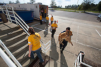 Jackie Beckstead, HSUS field responder, carries a dog into a temporary shelter at the Columbia, SC airport after a raid on a puppy mill in Johnston, SC on Tuesday, Sept. 11, 2012. HSUS workers found over 200 dogs, nine horses and 30-40 fowl.