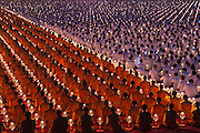 Buddhist monks gather together for the annual mass inauguration of new monks at the Wat Phra Dhammakaya, a Buddhist temple in Khlong Luang District, Pathum Thani Province north of Bangkok, Thailand. It is the centre of the Dhammakaya Movement, a Buddhist sect founded in the 1970s and led by Phra Dhammachayo.