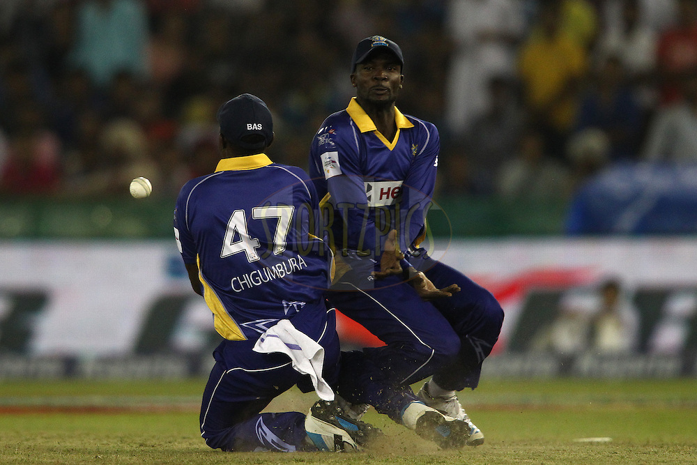 Elton Chigumbura of the Barbados Tridents drops a catch as he almost collides with Jonathan Carter of the Barbados Tridents during match 5 of the Oppo Champions League Twenty20 between the Kings XI Punjab and the Barbados Tridents held at the Punjab Cricket Association Stadium, Mohali, India on the 20th September 2014<br /> <br /> Photo by:  Shaun Roy / Sportzpics/ CLT20<br /> <br /> <br /> Image use is subject to the terms and conditions as laid out by the BCCI/ CLT20.  The terms and conditions can be downloaded here:<br /> <br /> http://sportzpics.photoshelter.com/gallery/CLT20-Image-Terms-and-Conditions-2014/G0000IfNJn535VPU/C0000QhhKadWcjYs