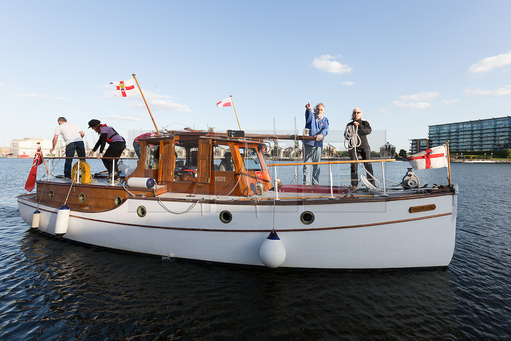 © Licensed to London News Pictures. 16/05/2015. London, UK. Crew of Dunkirk Little Ship, Papillon parades at Royal Victoria Dock in London this evening. Over 20 Dunkirk Little Ships have gathered in London toay before leaving in the morning to continue their journey to Dunkirk to mark the 75th anniversary of the Dunkirk Evacuations. Photo credit : Vickie Flores/LNP
