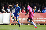 AFC Wimbledon striker Lyle Taylor (33) taking on Southend United defender Anton Ferdinand (35) during the EFL Sky Bet League 1 match between AFC Wimbledon and Southend United at the Cherry Red Records Stadium, Kingston, England on 25 March 2017. Photo by Matthew Redman.