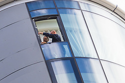 Men examine window attachments in the 27th storey penthouse apartment at The Corniche as a police cordon surrounding a forensics tent remains in place outside on the Albert Embankment in London after a window pane fell yesterday morning killing passing coach driver Mick Ferris. Albert Embankment, London, October 03 2018.