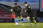 Forest Green Rovers midfielder Ebou Adams (14) sprints forward with the ball  supported by Forest Green Rovers forward (on loan from Celtic) Jack Aitchison (29) during the EFL Sky Bet League 2 match between Northampton Town and Forest Green Rovers at the PTS Academy Stadium, Northampton, England on 14 December 2019.