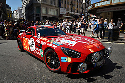 © Licensed to London News Pictures. 05/08/2018. LONDON, UK. A Mercedes Benz sets off from the start.  Gumball 3000, a charity rally for supercars and more, including celebrity entrants, begins in Covent Garden with 150 participants beginning their journey from London to Tokyo.  Photo credit: Stephen Chung/LNP