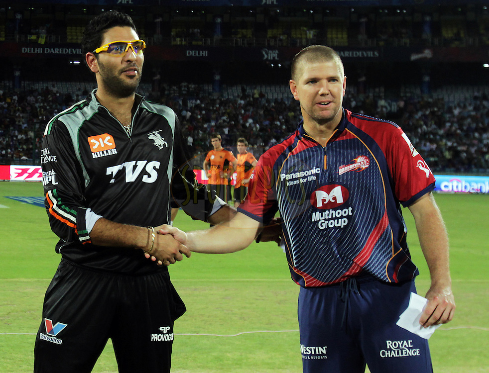Delhi Daredevils captain James Hopes and Pune Warriors captain Yuvraj Singh during the toss of match 68 of the Indian Premier League ( IPL ) Season 4 between the Delhi Daredevils and the Pune Warriors India held at the Feroz Shah Kotla Stadium in Delhi, India on the 21st May 2011..Photo by BCCI/SPORTZPICS.