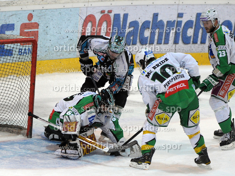 "15.03.2012, Keine Sorgen Eisarena, Linz, AUT, EBEL, EHC Liwest Black Wings Linz vs HDD Tilia Olimpija Ljubljana, Playoff, Halbfinale, 5. Spiel, im Bild Justin Keller (EHC Liwest Black Wings Linz, #14) and goalkeeper Matija Pintaric (HDD Tilia Olimpija Ljubljana, #69), during the semifinal match of ""Erste Bank Icehockey League"", fifth encounter between EHC Liwest Black Wings Linz and HDD Tilia Olimpija Ljubljana at Keine Sorgen Eisarena, Linz, Austria on 2012/03/15"