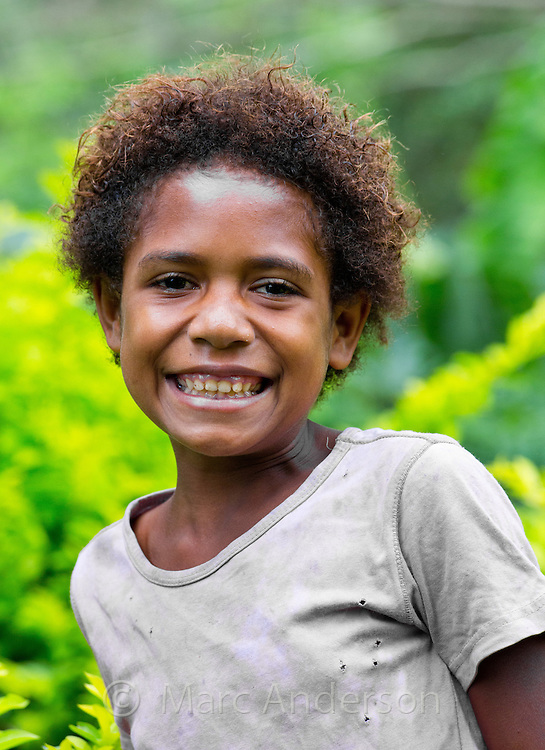 Young village girl smiling, Erap valley, Papua New Guinea