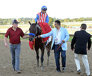 BENSALEM, PA - SEPTEMBER 20: Jockey Martin Garcia, riding Bayern, is walked to the winners circle with owner Kaleem Shah (2nd from right) after winning the Pennsylvania Derby September 20, 2014 at Parx Racing in Bensalem Pennsylvania. Bayern set the Parx track record for 1 1/8 miles at 1:46.96. (Photo by William Thomas Cain/Cain Images)