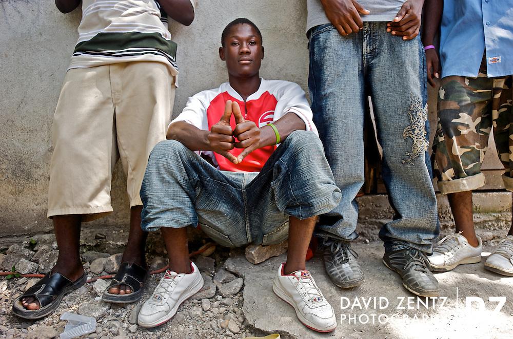 Aspiring rappers wait for a turn in a recording studio at Koze Kreyol, a gathering spot for aspiring rap kreyol artists, on July 21, 2008.