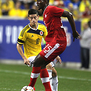 Doneil Henry, Canada, in action during the Columbia Vs Canada friendly international football match at Red Bull Arena, Harrison, New Jersey. USA. 14th October 2014. Photo Tim Clayton