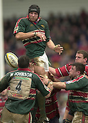 © Peter Spurrier/ Intersport Images.Photo Peter Spurrier.01/03/2003 Sport - Semi final Powergen Cup Rugby -.Leicester  v Gloucester - Franklin Gardens.Ben Kay direct the ball down to martin Johnson..