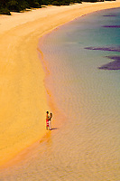 A honeymooning couple stroll a secluded beach, Vatulele Island Resort, Fiji Islands