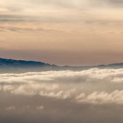 Mt. Diablo pokes out of an early morning fog bank over the San Francisco Bay Area. As seen from the summit of Mt. Tamilpais on the early morning of July 27, 2014 in Marin County, CA.
