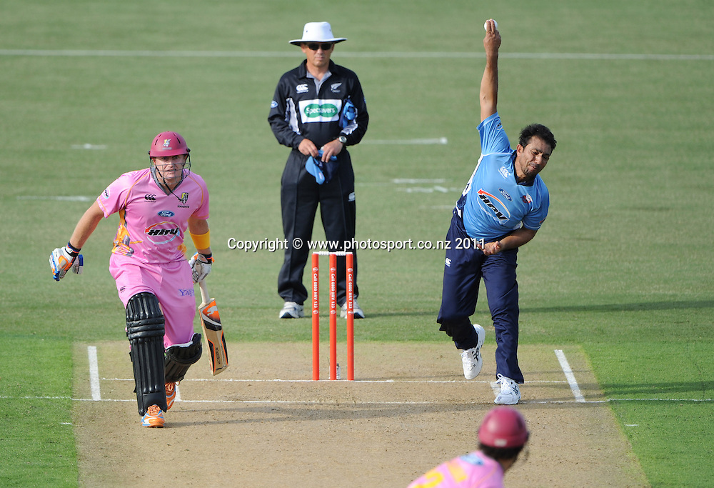 Auckland's Azhar Mahmood bowling during the HRV Twenty20 Cricket match between the Auckland Aces and Northern Knights at Colin Maiden Oval in Auckland on Monday 26 December 2011. Photo: Andrew Cornaga/Photosport.co.nz