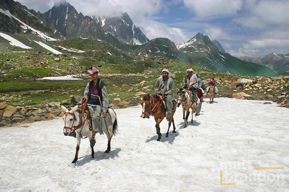 "Bakarwal Gujjar mean ride their ponies to work. These men are ""pony wallahs"" or porters for the Amarnath Yatra in Kashmir, India every year. Sonamarg, Kashmir, India"